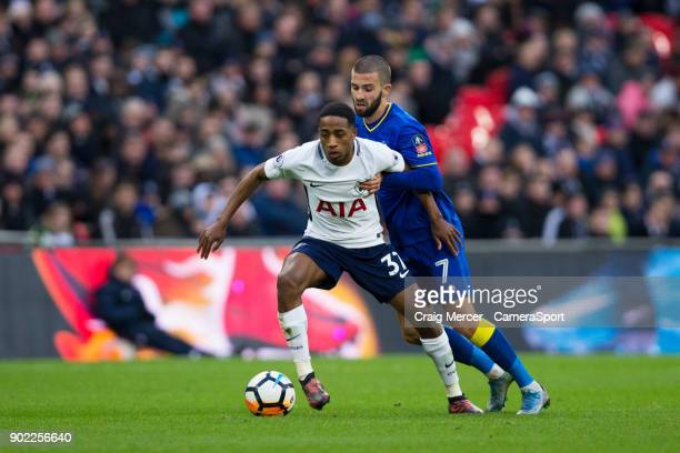 Tottenham Hotspur's Kyle WalkerPeters holds off the challenge from AFC Wimbledon's George Francomb during the Emirates FA Cup Third Round match...