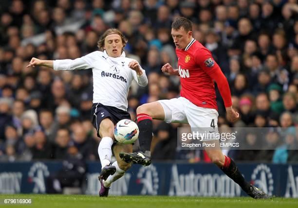 Tottenham Hotspur's Luka Modric and Manchester United's Phil Jones battle for the ball