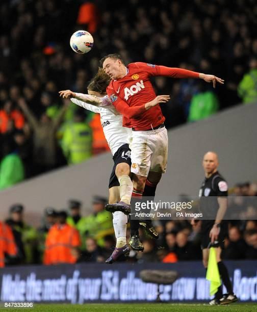 Tottenham Hotspur's Luka Modric and Manchester United's Phil Jones in action