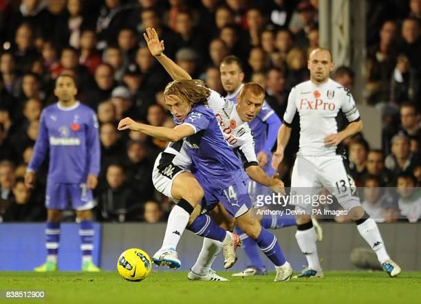 Tottenham Hotspur's Luka Modric holds off Fulham's Steve Sidwell