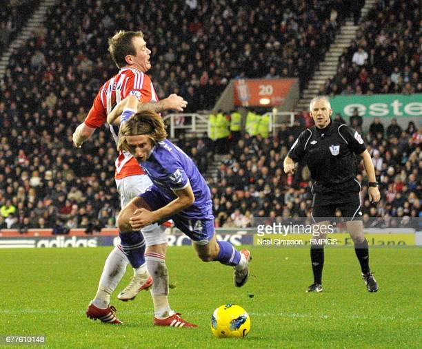 Tottenham Hotspur's Luka Modric is fouled in the area by Stoke City's Glenn Whelan and awarded a penalty by match referee Chris Foy