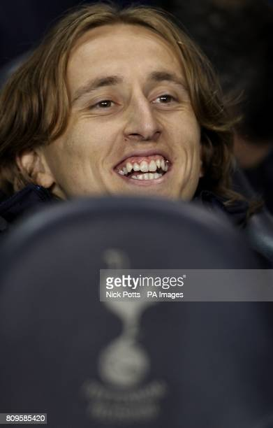 Tottenham Hotspur's Luka Modric laughs on the bench before the match