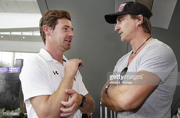 Tottenham Hotspur's manager Andre Villas_Boas speaks with David Ginola Barclays ambassador for the Asia Trophy 2013 at Hong Kong Airport the...