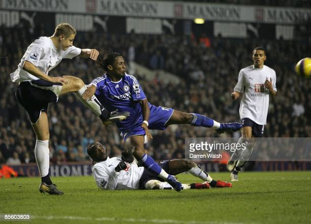 Tottenham Hotspurs' Michael Dawson clears under pressure from Chelsea's Didier Drogba