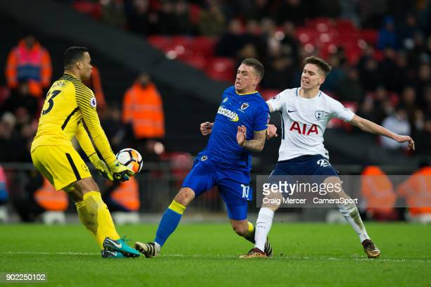 Tottenham Hotspur's Michel Vorm makes a save under pressure from AFC Wimbledon's Cody McDonald during the Emirates FA Cup Third Round match between...