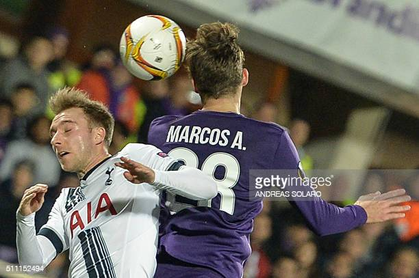 Tottenham Hotspurs midfielder from Denmark Christian Eriksen jumps for the ball against Fiorentina's defender from Spain Marcos Alonso Mendoza during...