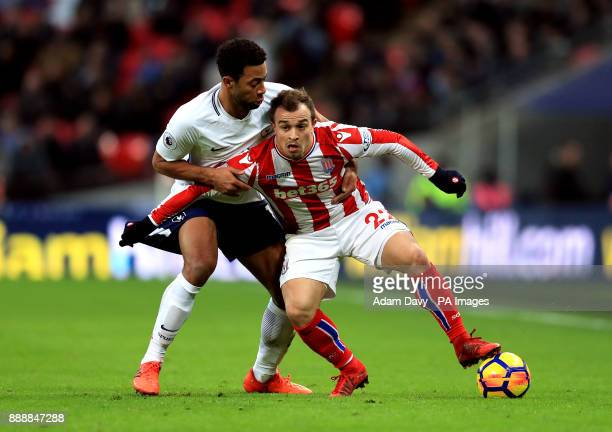 Tottenham Hotspur's Mousa Dembele and Stoke City's Xherdan Shaqiri battle for the ball during the Premier League match at Wembley Stadium London