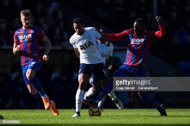 Tottenham Hotspur's Mousa Dembele battles for possession with Crystal Palace's Christian Benteke during the Premier League match between Crystal...