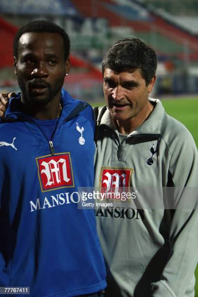 Tottenham Hotspur's new coach Juande Ramos speaks to Pascal Chimbonda during team training the day before their UEFA Cup Second Round Group G match...