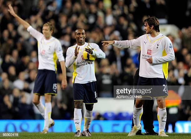 Tottenham Hotspurs' Niko Kranjcar gestures toward teammate Jermain Defoe at the end of the Premiership match against Wigan Athletic at White Hart...