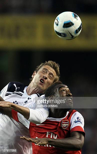 Tottenham Hotspurs' Peter Crouch vies for the ball against Arsenal's Ivoryan defender Johan Djourou during the Premiership football match at White...