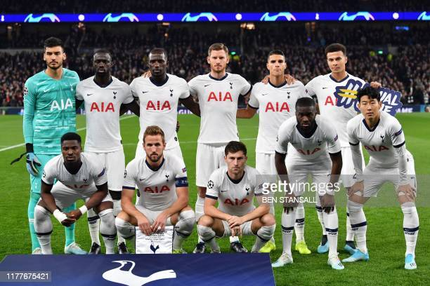 Tottenham Hotspur's players pose for a family photo before the UEFA Champions League Group B football match between Tottenham Hotspur and Red Star...
