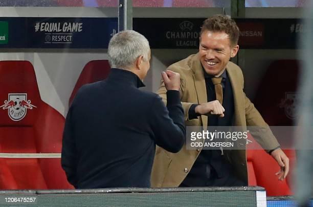 Tottenham Hotspur's Portuguese head coach Jose Mourinho and Leipzig's German headcoach Julian Nagelsmann do the elbow bump as they greet each other...