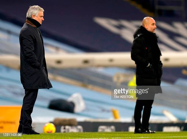 Tottenham Hotspur's Portuguese head coach Jose Mourinho and Manchester City's Spanish manager Pep Guardiola watch during the English Premier League...