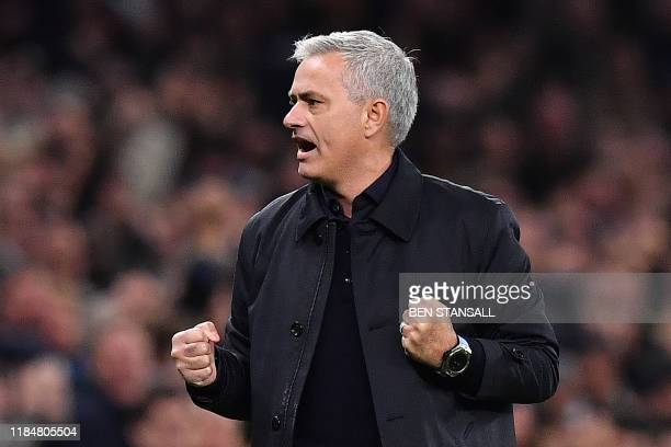 Tottenham Hotspur's Portuguese head coach Jose Mourinho celebrates as Tottenham Hotspur's English striker Harry Kane scores his team's second goal...