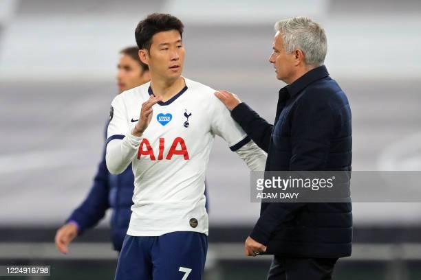 Tottenham Hotspur's Portuguese head coach Jose Mourinho congratulates Tottenham Hotspur's South Korean striker Son Heung-Min following the English...