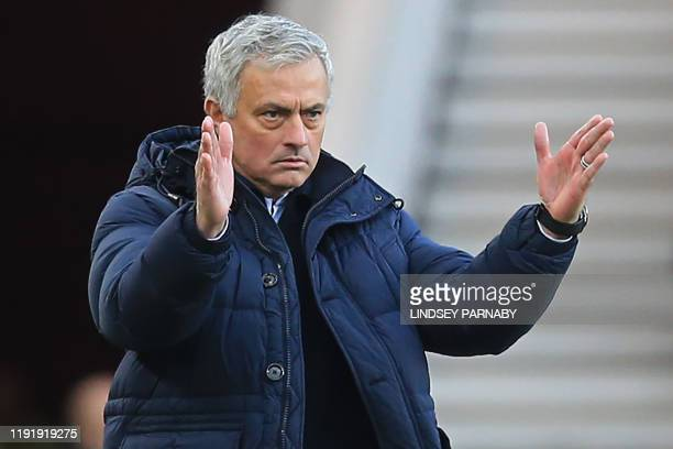 Tottenham Hotspur's Portuguese head coach Jose Mourinho gestures on the touchline during the English FA cup third round football match between...