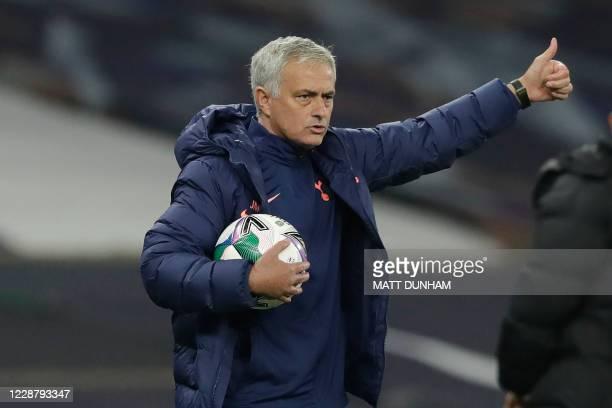Tottenham Hotspur's Portuguese head coach Jose Mourinho gestures during the English League Cup fourth round football match between Tottenham Hotspur...