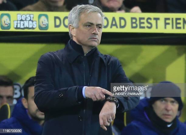 Tottenham Hotspur's Portuguese head coach Jose Mourinho gestures to his watch from the touchline during the English Premier League football match...