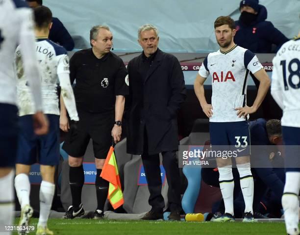 Tottenham Hotspur's Portuguese head coach Jose Mourinho introduces Tottenham Hotspur's Welsh defender Ben Davies as a substitute during the English...
