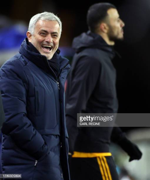 Tottenham Hotspur's Portuguese head coach Jose Mourinho laughs as he arrives for the English Premier League football match between Wolverhampton...