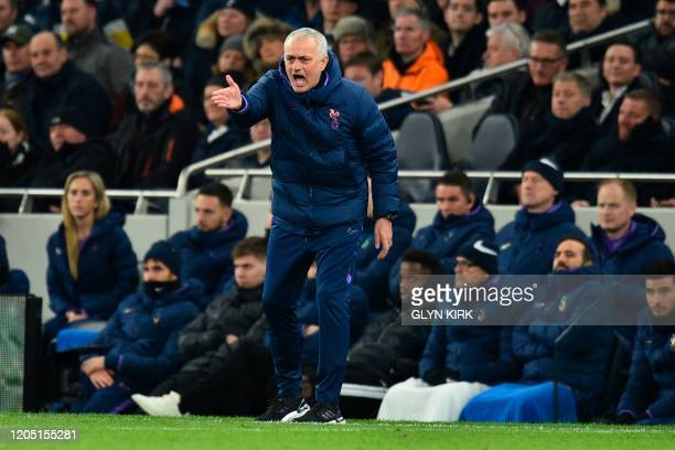 Tottenham Hotspur's Portuguese head coach Jose Mourinho shouts instructions to his players from the touchline during the English FA Cup fifth round...