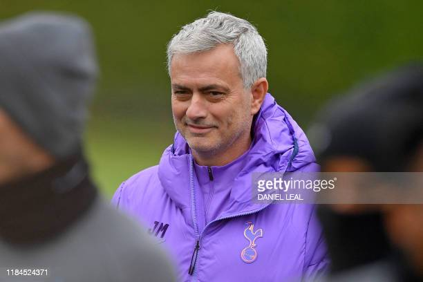Tottenham Hotspur's Portuguese head coach Jose Mourinho smiles as he takes a team training session at Tottenham Hotspur's Enfield Training Centre in...