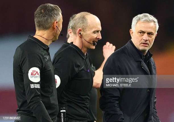 Tottenham Hotspur's Portuguese head coach Jose Mourinho speaks to referee Mike Dean after the English Premier League football match between Aston...