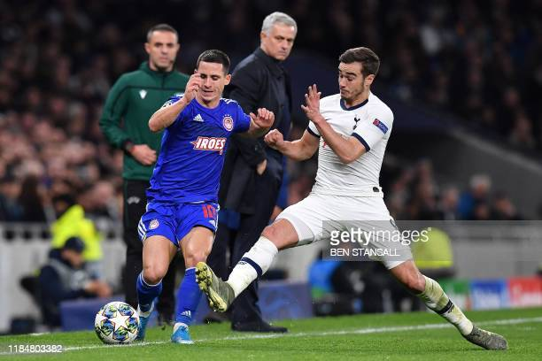 Tottenham Hotspur's Portuguese head coach Jose Mourinho watches as Tottenham Hotspur's English midfielder Harry Winks vies with Olympiakos'...