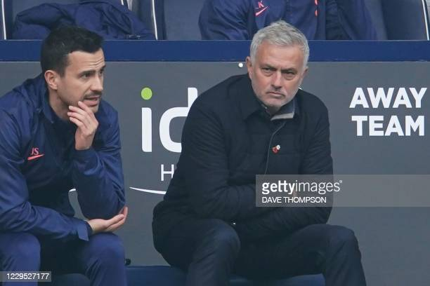 Tottenham Hotspur's Portuguese head coach Jose Mourinho watches from the away team's bench during the English Premier League football match between...