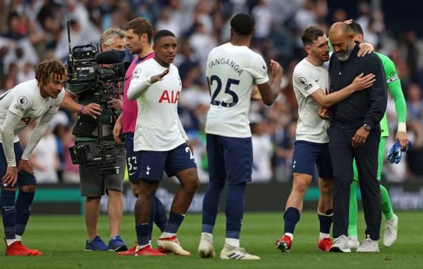 Tottenham Hotspur's Portuguese head coach Nuno Espirito Santo is congratulated by his players after they won the English Premier League football...