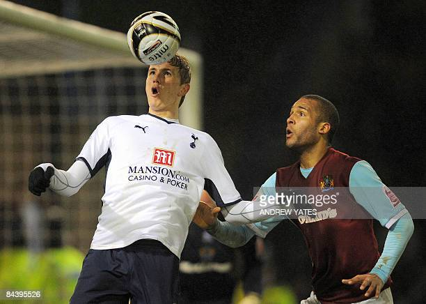Tottenham Hotspur's Russian forward Roman Pavlyuchenko controls the ball infront of Burnley's English defender Clarke Carlisle during the Carling Cup...