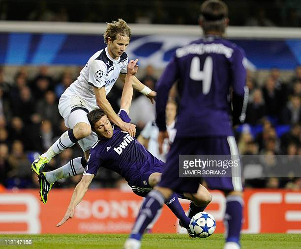 Tottenham Hotspur's Russian player Roman Pavlyuchenko vies with Real Madrid's Xabi Alonso during their UEFA Champions League Quarter Final second leg...