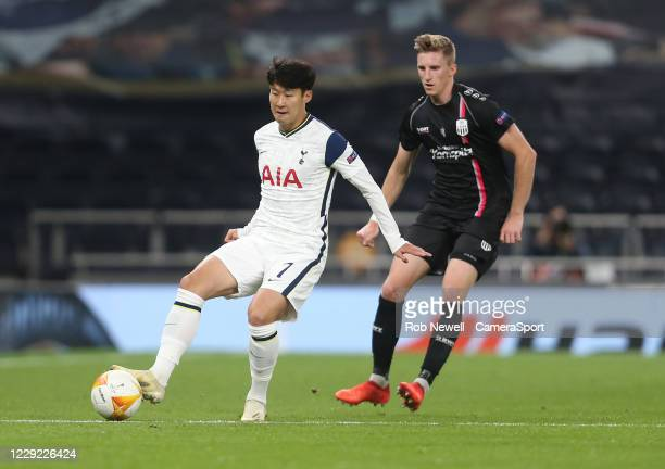 Tottenham Hotspur's Son Heung-Min and LASK's Philipp Wiesinger during the UEFA Europa League Group J stage match between Tottenham Hotspur and LASK...