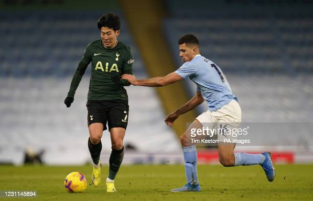 Tottenham Hotspur's Son Heung-min and Manchester City's Rodri battle for the ball during the Premier League match at the Etihad Stadium, Manchester....