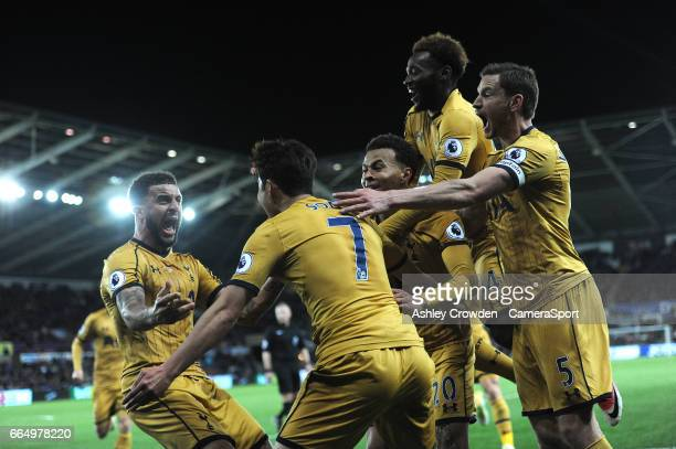 CELE Tottenham Hotspur's Son HeungMin celebrates scoring his sides second goal with team mates during the Premier League match between Swansea City...