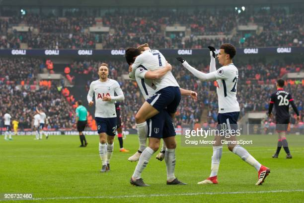 Tottenham Hotspur's Son HeungMin celebrates scoring his side's second goal with team mate Harry Kane during the Premier League match between...