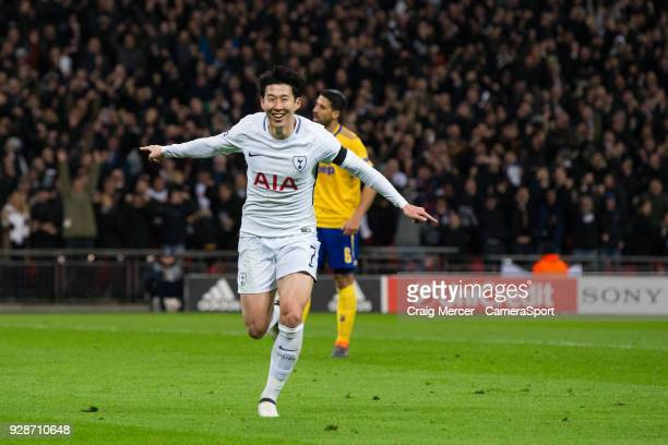 Tottenham Hotspur's Son HeungMin celebrates scoring the opening goal during the UEFA Champions League Round of 16 Second Leg match between Tottenham...