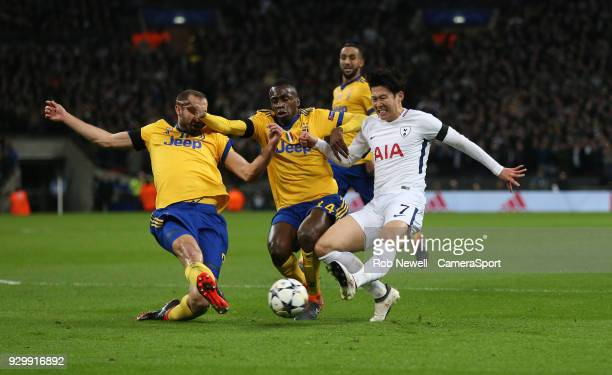 Tottenham Hotspur's Son HeungMin is challenged by Giorgio Chiellini and Blaise Matuidi of Juventus during the UEFA Champions League Round of 16...