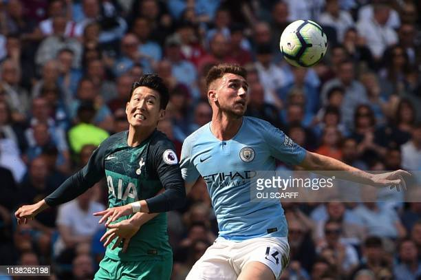 Tottenham Hotspur's South Korean striker Son HeungMin and Manchester City's French defender Aymeric Laporte vie for the ball during the English...