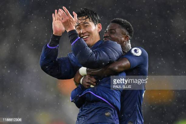 Tottenham Hotspur's South Korean striker Son Heung-Min and Tottenham Hotspur's Ivorian defender Serge Aurier celebrate on the pitch after the English...