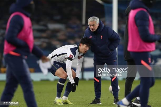 Tottenham Hotspur's South Korean striker Son Heung-Min and Tottenham Hotspur's Portuguese head coach Jose Mourinho react at the final whistle during...