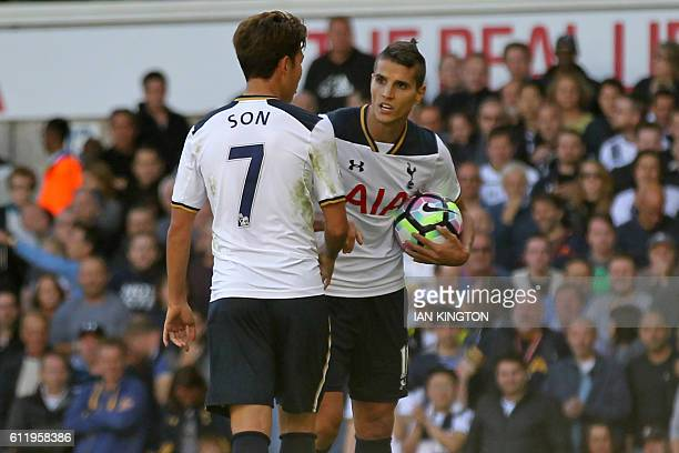 Tottenham Hotspur's South Korean striker Son HeungMin and Tottenham Hotspur's Argentinian midfielder Erik Lamela clash before Tottenham Hotspur's...