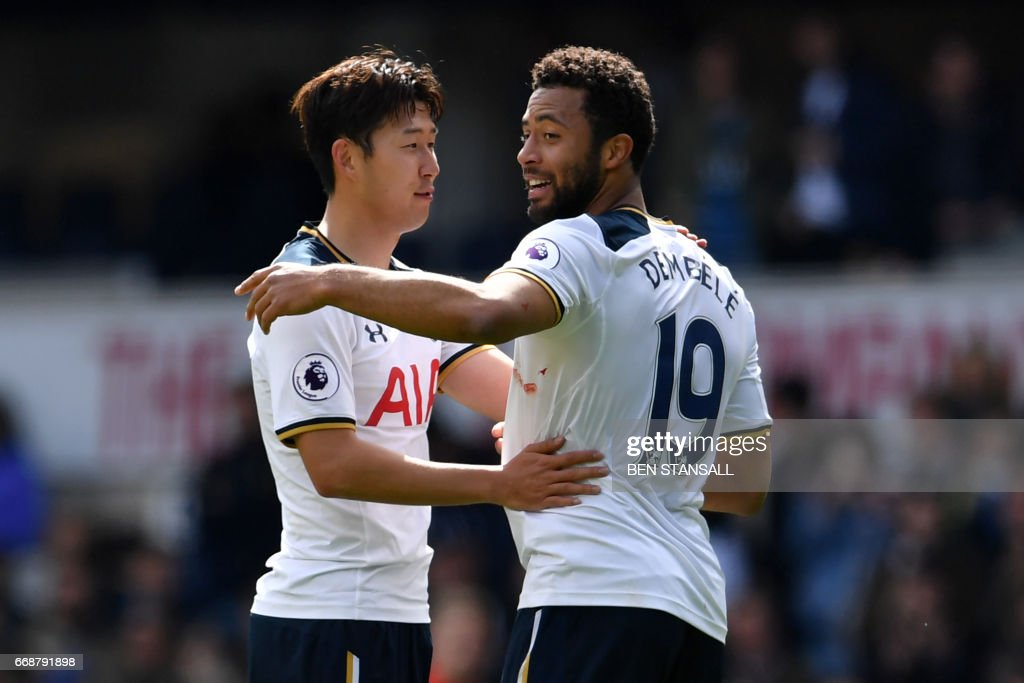 Tottenham Hotspur's South Korean striker Son Heung-Min (L) and Tottenham Hotspur's Belgian midfielder Mousa Dembele celebrate on the pitch after the English Premier League football match between Tottenham Hotspur and Bournemouth at White Hart Lane in London, on April 15, 2017. Tottenham won the game 4-0. / AFP PHOTO / Ben STANSALL / RESTRICTED TO EDITORIAL USE. No use with unauthorized audio, video, data, fixture lists, club/league logos or 'live' services. Online in-match use limited to 75 images, no video emulation. No use in betting, games or single club/league/player publications. /