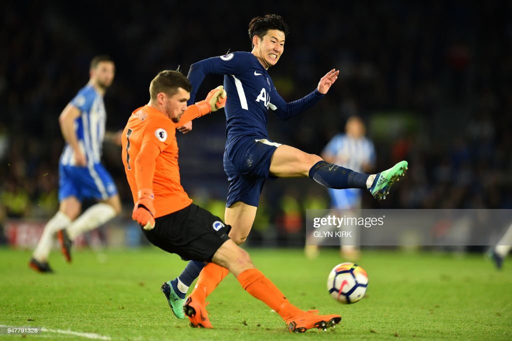 Tottenham Hotspur's South Korean striker Son Heung-Min (R) attempts to block Brighton's Australian goalkeeper Mathew Ryan from making a goal kick during the English Premier League football match between Brighton and Hove Albion and Tottenham Hotspur at the American Express Community Stadium in Brighton, southern England on April 17, 2018. / AFP PHOTO / Glyn KIRK / RESTRICTED TO EDITORIAL USE. No use with unauthorized audio, video, data, fixture lists, club/league logos or 'live' services. Online in-match use limited to 75 images, no video emulation. No use in betting, games or single club/league/player publications. /