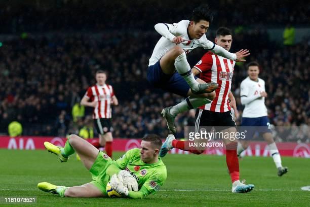 TOPSHOT Tottenham Hotspur's South Korean striker Son HeungMin avoids a challenge by Sheffield United's English goalkeeper Dean Henderson during the...
