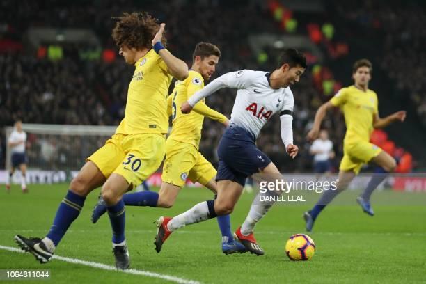 Tottenham Hotspur's South Korean striker Son HeungMin beats Chelsea's Brazilian defender David Luiz and Chelsea's Italian midfielder Jorginho on his...