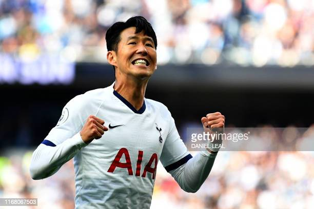 Tottenham Hotspur's South Korean striker Son HeungMin celebrates after he scores the team's first goal during the English Premier League football...