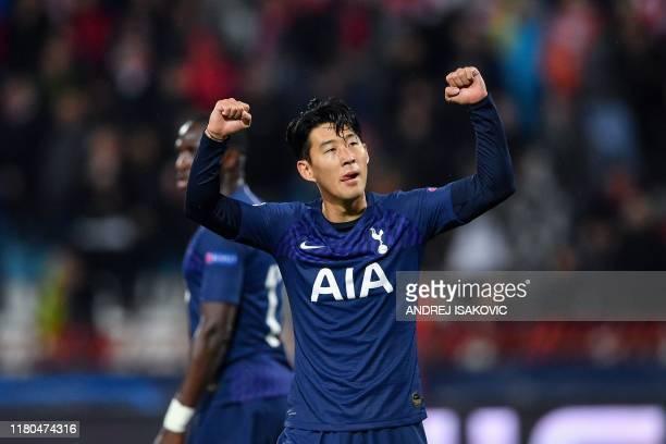 Tottenham Hotspur's South Korean striker Son Heung-Min celebrates after scoring his team's third goal during the UEFA Champions League Group B...