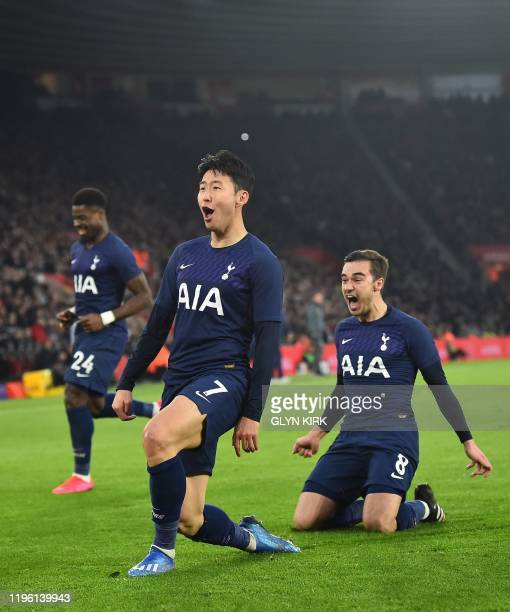 Tottenham Hotspur's South Korean striker Son HeungMin celebrates after scoring the opening goal during the English FA Cup fourth round football match...